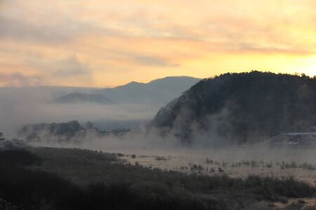 Winter morning sunrise landscape of water misty rivers and mountains. Soyang River, Chuncheon City, Korea