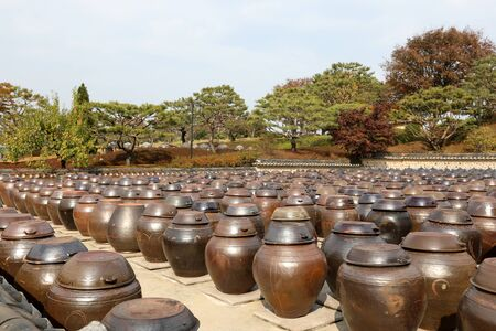 Korean traditional clay pot and stone wall 스톡 콘텐츠