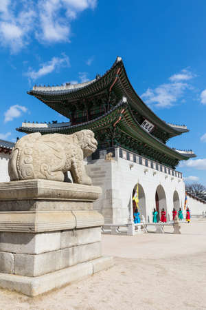 Gyeongbokgung Palace, Seoul, South Korea-February 27, 2020: Haetae statue and traditional costume guard in front of Gwanghwamun