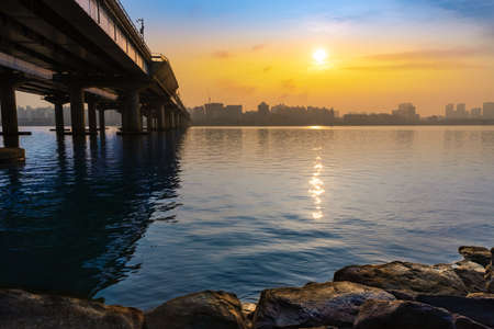 Beautiful Korean summer Seoul scenery. Bridge connecting the Hangang River in Seoul, beautiful sunrise over the building.
