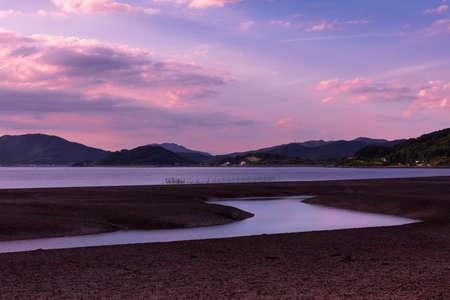 Beautiful sea sunset time, tidal flat landscape reflecting the sky at low tide. Ganghwa-gun, Incheon, South Korea Stock Photo