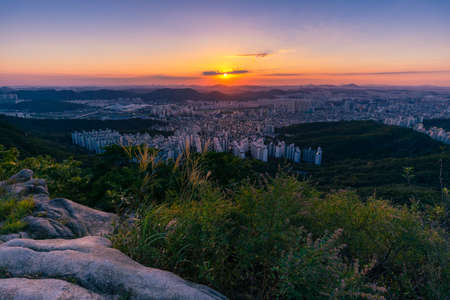 Beautiful sunset in Seoul seen from the top of the mountain. Hoamsan Mountain in Seoul, South Korea.