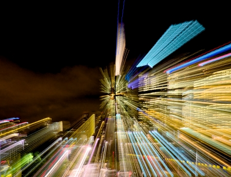 Abstract streaks of lights from the building at night in Melbourne photo