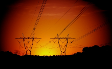 beautiful sunset with electrical pylons on the hills in Melbourne photo
