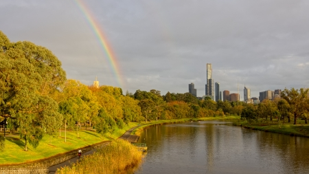 early morning rainbow over the city of melbourne in fall photo
