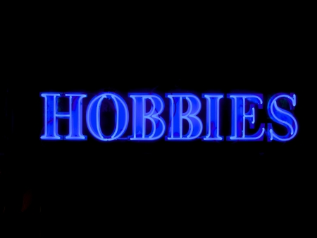 boring frame: the word hobbies witten in blue neon