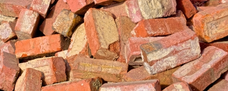 demolished house: study of a pile of old red bricks from a demolished house
