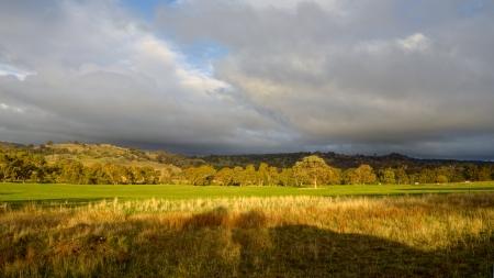 Beautiful sweeping Australian farmland on a rainy day Stock Photo - 20872221