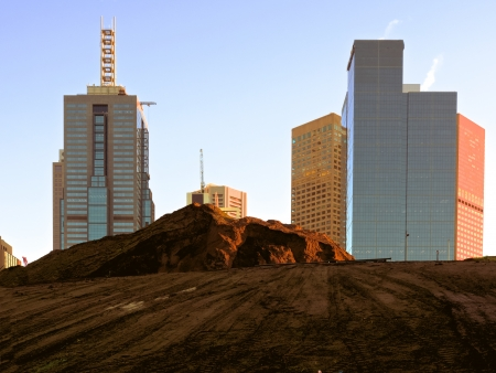 New building excavation with Melbourne city skyscrapers behind
