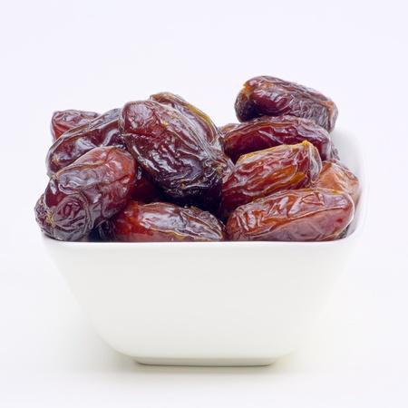 especially: white bowl of dates especially for ramadan Stock Photo