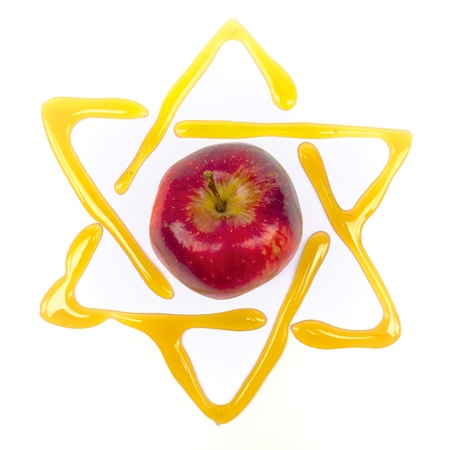 rosh: honey and apple  traditional food at yom kippur with a star of david