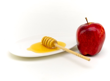 honey and apple representing traditional food at yom kippur breaking of the fast