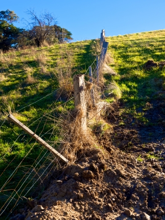 broken rural wire fence in need of repair Stock Photo - 21017845