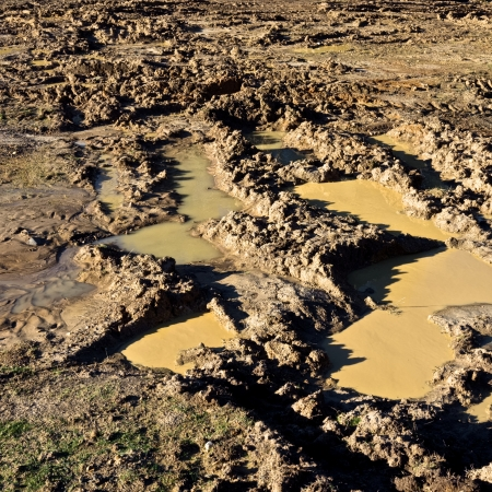very muddy track left by four wheel drive vehicle