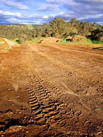 muddy tracks left by a car doing off road driving in australia photo