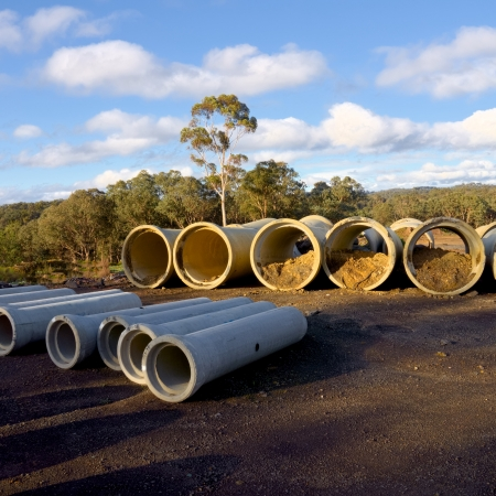 row of large storm water concrete pipes Stock Photo