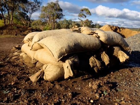pile of sand bags ready for an emergency photo