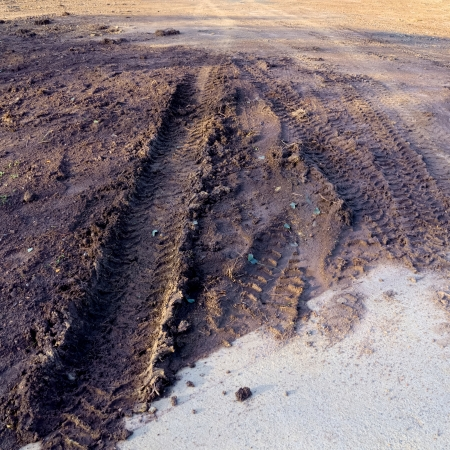 muddy track left by a four wheel drive car photo