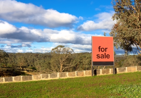 housing lot: for sale sign in front of a beautiful block in melbourne australia Stock Photo
