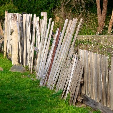 broken wooden fence in desperate need of repair Stock Photo