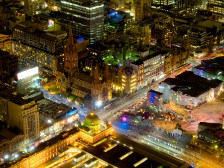 federation: night view of melbourne city from above showing flinders st station and federation square under lights