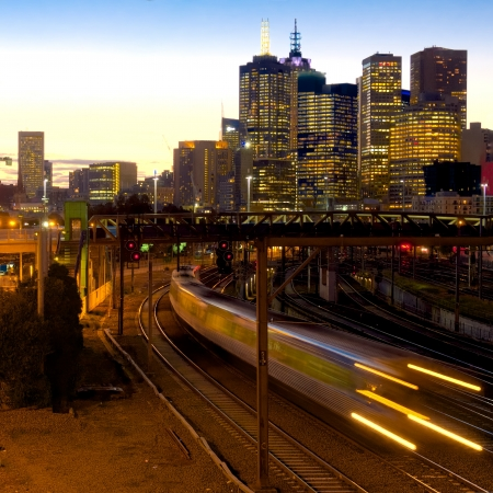 electric train at dusk heading away from Melbourne