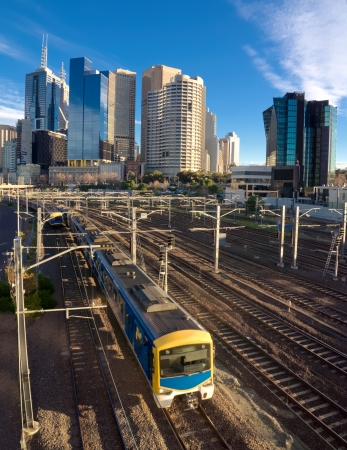 public transport train travelling out of central melbourne Stock Photo