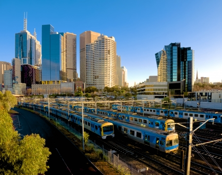several trains heading out of Melbourne on a sunny morning
