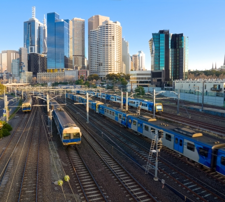 four trains travelling in and out of Melbourne photo