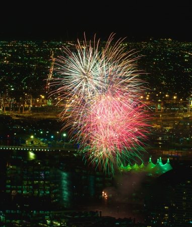 Explosion of fireworks over the harbour at docklands in Melbourne