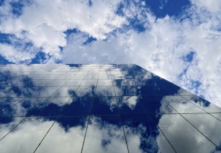 nice blue cloudy sky reflected in a modern glass building in melbourne photo
