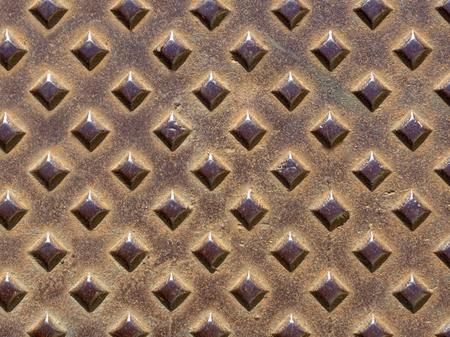 diamond shaped: rusty metal plate with diamond shaped bumps