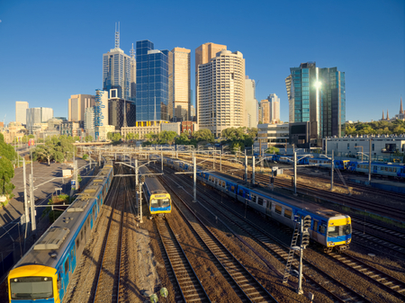 trains travelling into and out of melbourne city at peak hour Stock Photo