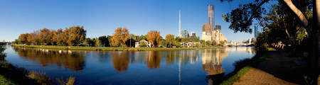 panorama of melbourne on a sunny autumn day with yarra river in foreground photo