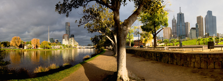panorama of melbourne on a cloudy autumn day with yarra river split into a north and south view photo