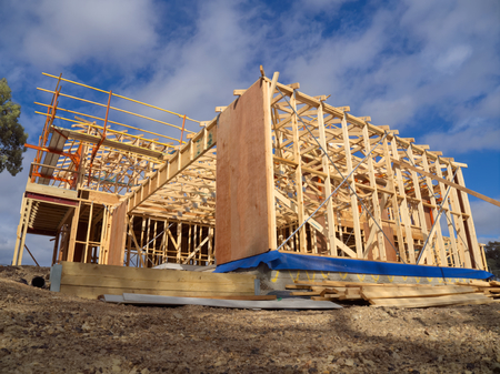 wooden frame of a house being built in melbourne photo