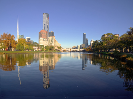 melbourne on a sunny autumn day with yarra river in foreground photo