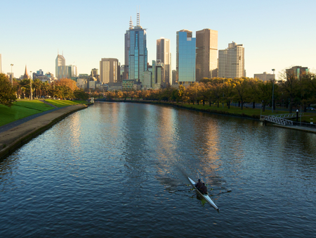 southbank: melbourne with rowers on the yarra river