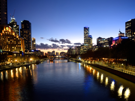 melbourne reflected in the yarra river at dusk