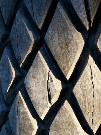 interesting cross hatch patter on a wooden pole photo