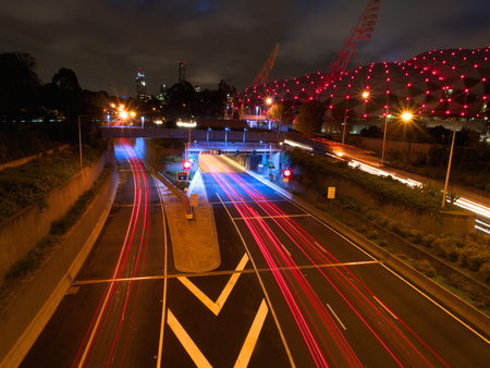 southbank: light trails left by traffic travelling into melbourne australia