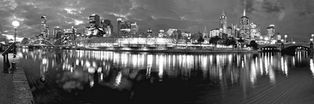 black and white melbourne at night reflected in the yarra river photo