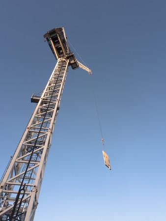 construction crane lifting a concrete slab on a building site in melbourne australia