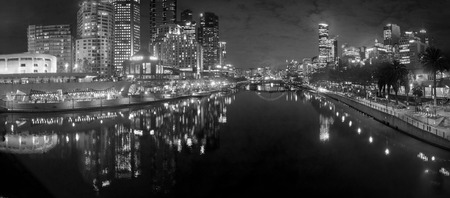 black and white melbourne city reflected in the yarra river at night and white melbourne city reflected in the yarra river at night