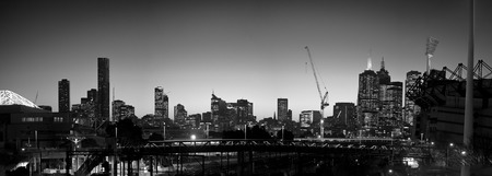 Melbourne skyline at night in black and white with railway and mcg