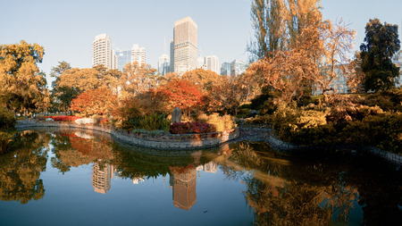 melbourne on a sunny autumn (fall) morning with autumn tree reflected ina pond Stock Photo