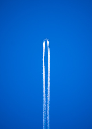 vapor trails left by a high flying jet