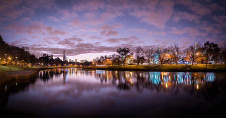 panorama of melbourne city australia at night looking down the yarra river at sunset Stock Photo