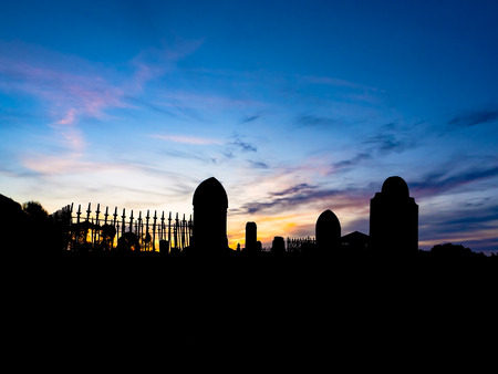 Silhouette of a graveyard  in rural Victoria Australia with a sunset Stock Photo