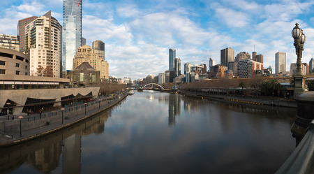 melbourne reflected in the yarra river on a cold winter day